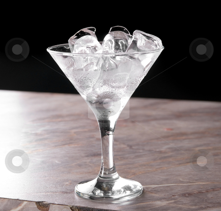 Ice stock photo, ice at cocktail glass at bar table by olinchuk