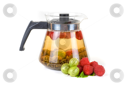 Berry tea stock photo, Teapot with fruit tea and berries on a white background by olinchuk