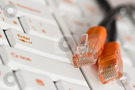 PC keyboard stock photo, PC keyboard with orange print and orange network cord ends by ludinko
