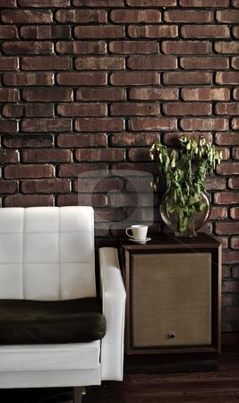 Retro House stock photo, Retro styled lounge room showing a couch, speakers, cup, plant on wooden floor and a brick wall. by thisboy