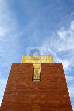 Brick Tower stock photo, A brick tower with yellow glass at the top by Kevin Tietz