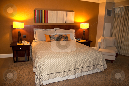Hotel Bedroom stock photo, A hotel bedroom with nightstand and lights by Kevin Tietz