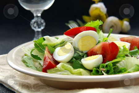 Salad with quail eggs and arugula on beige plate  black background stock photo, salad with quail eggs and arugula on beige plate  black background by Olga Kriger