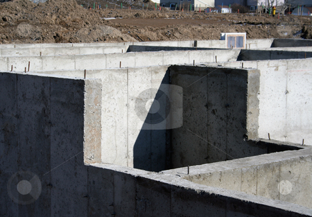 Cement Foundation stock photo, The cement foundation of a new housing development. by Chris Hill