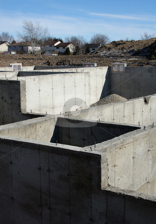 New Housing Development stock photo, The cement foundation of a new housing development.  by Chris Hill