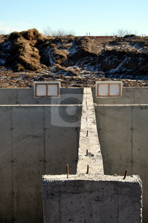 Foundation Wall stock photo, The cement foundation of a new housing development.  by Chris Hill