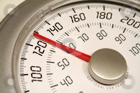 Weigh In stock photo, A close up of a weight scale set at 128.  by Chris Hill
