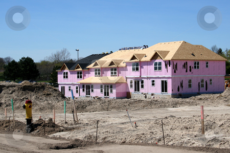New Townhouse stock photo, A brand new townhouse complex in mid-construction. by Chris Hill