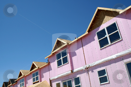 Townhouse Under Construction stock photo, A brand new townhouse complex in mid construction.