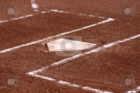 Home Plate Close-up stock photo, A close-up of the batters boxes and home plate on a vacant baseball diamond.  by Chris Hill