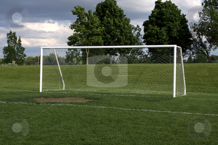Open Soccer Goal stock photo, A view of a net on a vacant soccer pitch.  by Chris Hill
