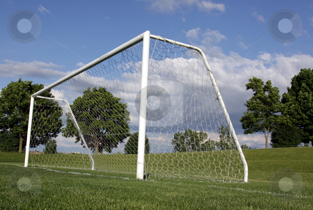 From the Goal Line stock photo, A view of a net on a vacant soccer pitch.  by Chris Hill