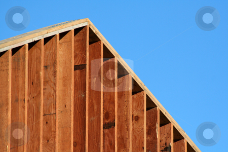 Red Wood Frame stock photo, The wooden frame of a large new house.  by Chris Hill