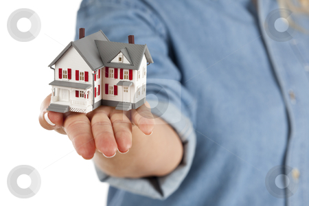 House in Female Hand on White stock photo, Model House in Female Hand Isolated on One Side with a White Background. by Andy Dean