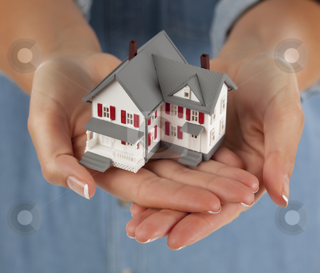 Woman Holding Model Home in Hands stock photo, Woman Holding a Model Home in Her Hands. by Andy Dean