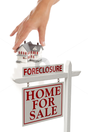 Womans Hand Choosing Home with Foreclosure Real Estate Sign stock photo, Womans Hand Choosing House with Foreclosure Home For Sale Real Estate Sign in Front Isolated on White. by Andy Dean