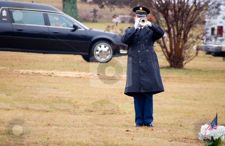 Bugler stock photo, A bugler paying Taps at a military funeral. by Robert Byron