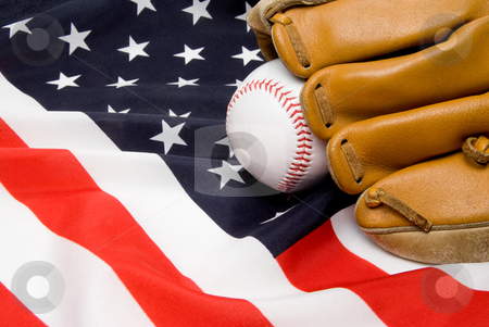 Baseball and Glove stock photo, A Baseball and Glove on an American Flag. by Robert Byron