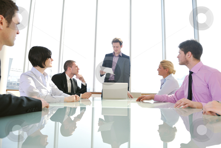 Group of business people at meeting stock photo, young business people group have  meeting at conference room and have discusion  about new ideas  plans and problems by Benis Arapovic