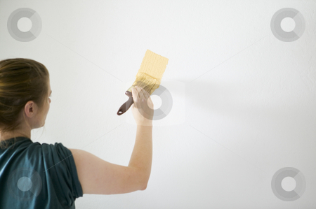 Woman painting stock photo, Woman painting white wall with bright yellow paint, concept photography, model released by Bryan Mullennix