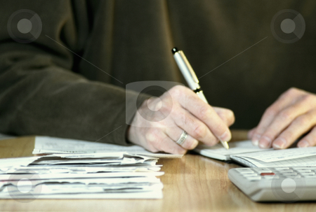 Paying bills stock photo, Man paying bills, concept photography, model released by Bryan Mullennix