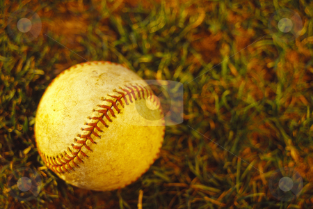 Baseball stock photo, Baseball laying on ground in warm afternoon light, concept photography by Bryan Mullennix