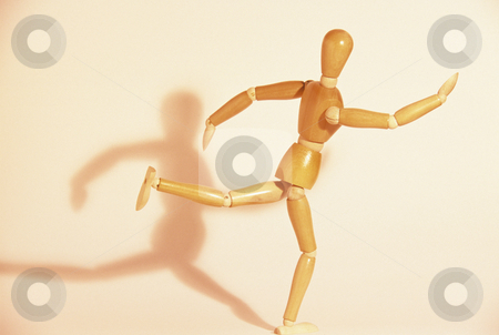 Wooden Mannequin Running stock photo, Artists mannequin and shadow, concept photography by Bryan Mullennix