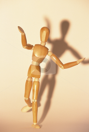 Wooden Mannequin stock photo, Artists mannequin standing on one leg, concept photography by Bryan Mullennix