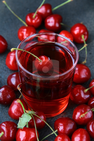 Glass of fresh cherry juice and fresh cherries stock photo, glass of fresh cherry juice and fresh cherries by Olga Kriger