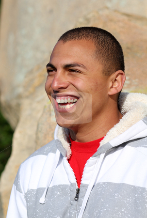 Laughter stock photo, Young latino man laughing outdoors by allihays