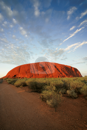 Ayers Rock stock photo, Uluru (Ayers Rock) early in the morning as the sun turns it bright red. by &copy; Ron Sumners