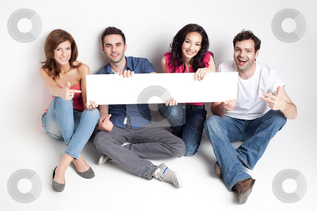 Happy friends showing white banner stock photo, four friends showing a white board by dan comaniciu