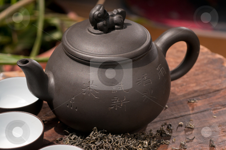 Chinese green tea pot and cups stock photo, chinese green tea traditional  pot and cups over old wood board  by Francesco Perre