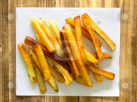 French fries on paper stock photo, close up of french fries on paper by zkruger