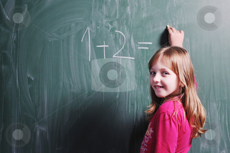 Happy young school girl portrait stock photo, happy young school girl portrait on math class by Benis Arapovic