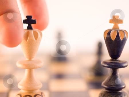 The move of the king stock photo, Conceptual with wood chess pieces by Perseomedusa