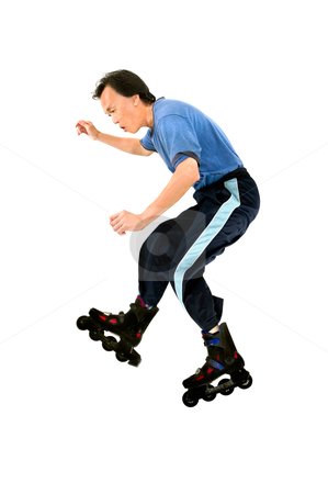 Man on roller skates stock photo, action rollerblading sports man on roller blades isolated copyspace by JOSEPH S.L. TAN MATT