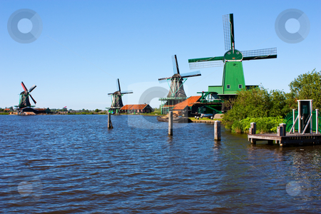 Mills in Holland stock photo, Mills in Holland, traditional and direct landmark of the country by Perseomedusa