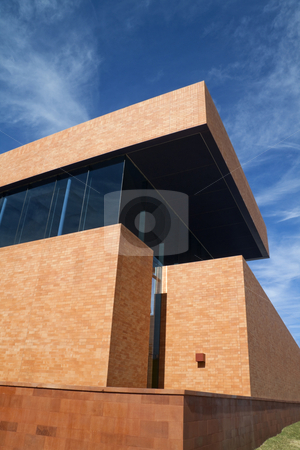 Brick Building stock photo, A modern brick building with a blue sky by Kevin Tietz