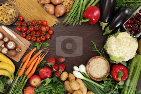 Healthy eating frame stock photo, Photo of a table top full of fresh vegetables, fruit, and other healthy foods with a space in the middle for text. by © Ron Sumners