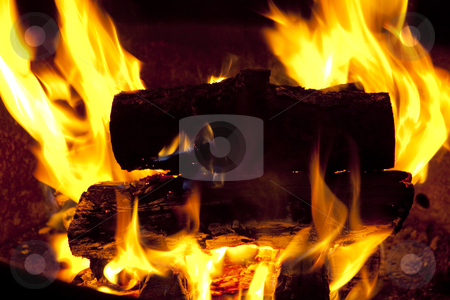 Campfire Burning stock photo, Roaring fire in a fire pit by Bryan Mullennix