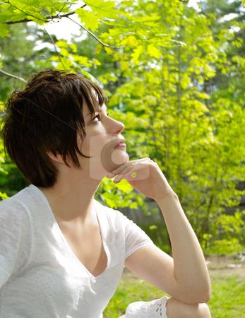 Girl enjoying summer sunshine in garden stock photo, girl in light soft white summer dress enjoying  sunshine in garden. slight breeze create moire effect to the trees. by JOSEPH S.L. TAN MATT