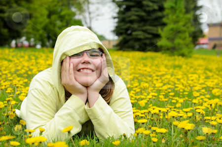 Field of Dandelions Portrait stock photo, A young girl lying in a field of dandelions. by Richard Nelson