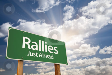 Rallies Green Road Sign Against Clouds stock photo, Rallies Green Road Sign Against Clouds and Sunburst. by Andy Dean