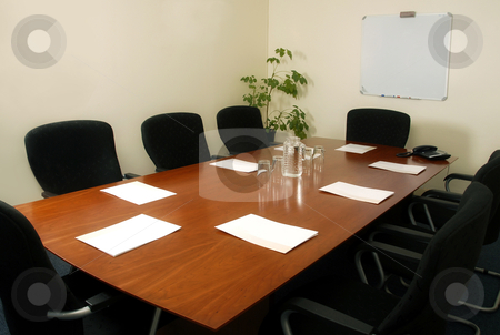 Boardroom table stock photo, Boardroom table with places set ready for a meeting by Mornay Van Vuuren