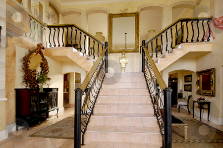 Y-shaped staircase stock photo, Exquisite Y-shaped staircase in a house with autumn tones by Mornay Van Vuuren