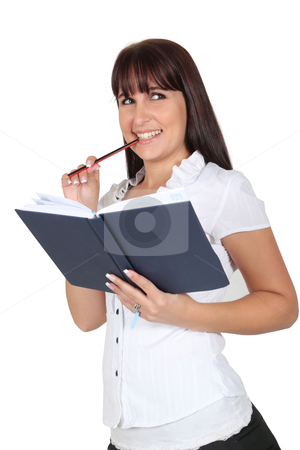 Thinking while holding a diary stock photo, Woman thinking while holding a diary and a pencil by Mornay Van Vuuren