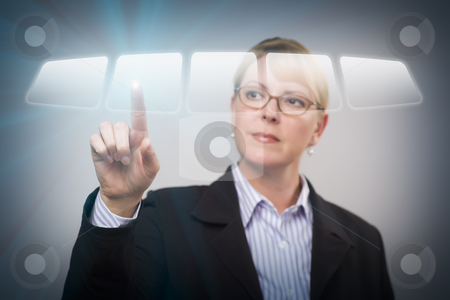 Woman Pushing an Interactive Touch Screen Button stock photo, Attractive Blonde Woman Using an Interactive Touch Screen. by Andy Dean
