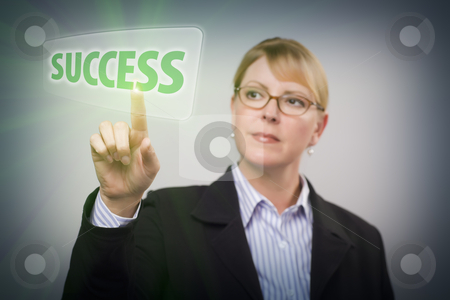 Woman Pushing Success Button on Interactive Touch Screen stock photo, Attractive Blonde Woman Pushing Success Button on an Interactive Touch Screen. by Andy Dean