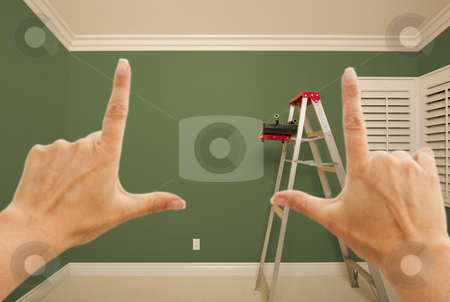 Hands Framing Green Painted Wall Interior stock photo, Hands Framing Green Painted Room Wall Interior with Ladder, Paint Bucket and Rollers. by Andy Dean